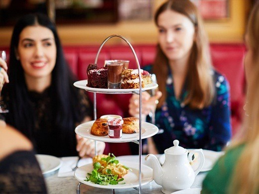 Waitress and free afternoon tea with a glass of prosecco at Cafe Rouge-